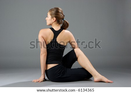 Young women doing yoga exercise - stock photo