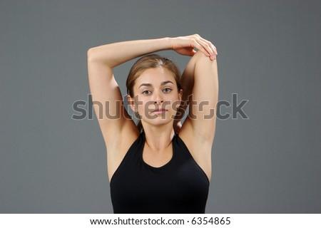 young women doing Yoga exercises - stock photo