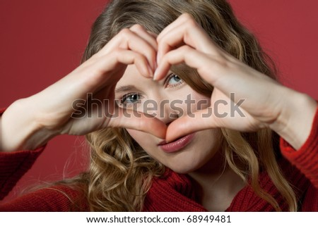 young women formed a heart with the hands - stock photo