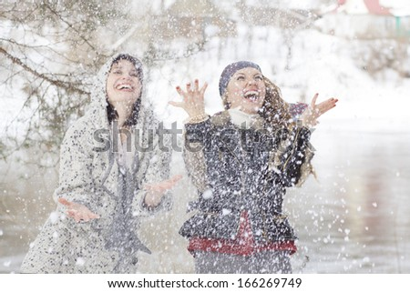 young women funny laughing outdoor in winter - stock photo
