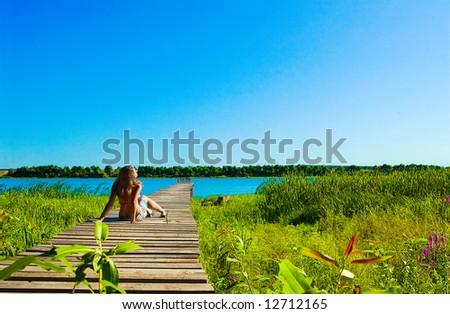 Young women getting a suntan - stock photo
