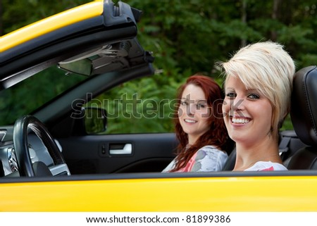 Young women going for a drive - stock photo