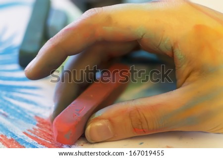 young women hand draw with colored chalk - stock photo