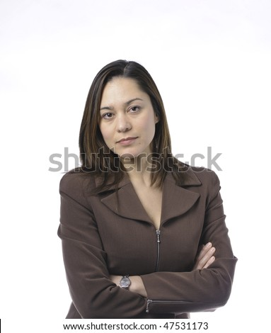 Young women has her arms crossed.She is of mixed race.Wearing a brown suit and has long brown hair. - stock photo