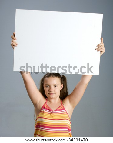 Young women holding a blank sign