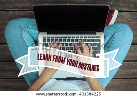 Young women holding laptop writen Learn From Your Mistakes on it