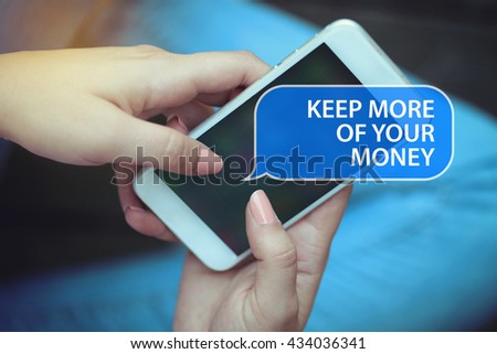 Young women holding mobile phone writen Keep More Of Your Money on it - stock photo