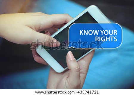 Young women holding mobile phone writen Know Your Rights on it - stock photo