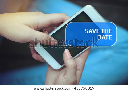 Young women holding mobile phone writen Save The Date  on it - stock photo