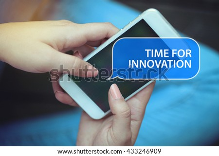 Young women holding mobile phone writen Time For Innovation on it - stock photo