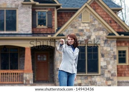 Young Women Holding Out Keys - stock photo