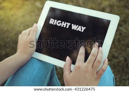 Young women holding tablet writen Right Way on it - stock photo