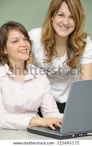Young women in an office - stock photo