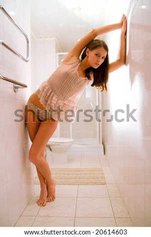 young women in bathroom - stock photo