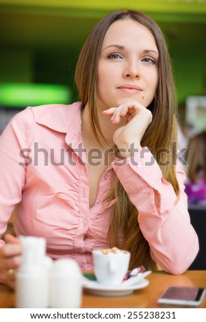 Young women in coffee shop / Beautiful women drinking a cappuccino - stock photo
