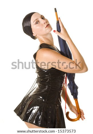 Young women in leather clothes with umbrella on white - stock photo