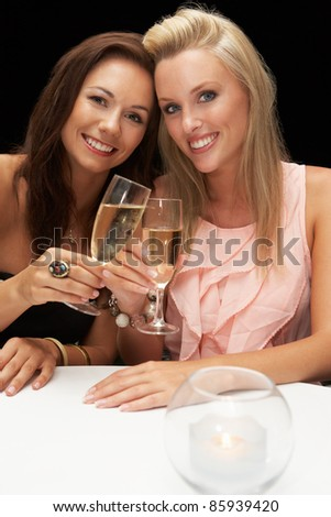 Young women in restaurant - stock photo