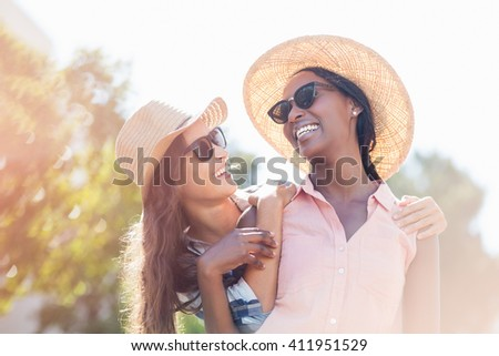 Young women in sunglasses having fun - stock photo