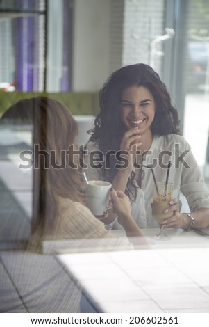 Young women in the cafe - stock photo
