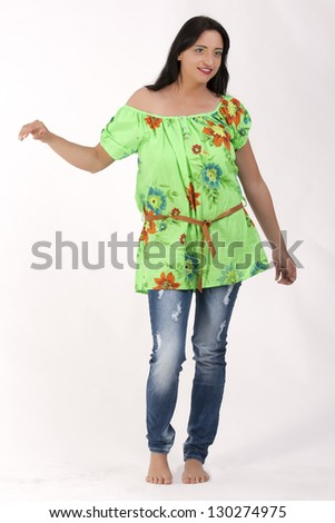 Young women in the current trend floral print on an elegant and grown-kind / Flower-Power - stock photo