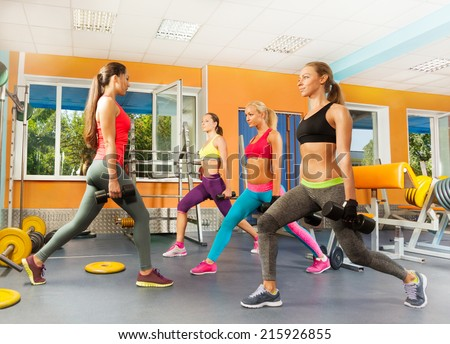 Young women in the gym doing crossfit excercises - stock photo