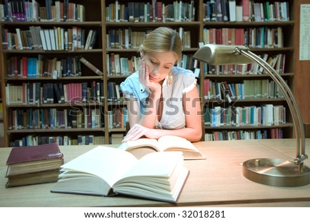Young women in the library - stock photo