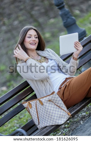 Young women in the park with tablet
