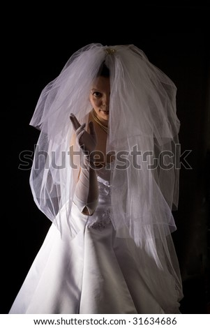 young women in the veil and white dress
