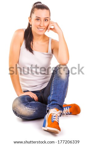 Young women in white t-shirts and blue jeans - stock photo