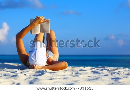 Young women is resting on the coral beach, Maldives - stock photo