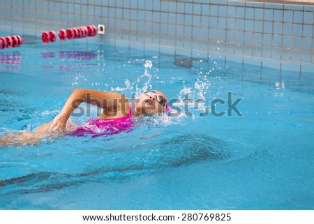 young women is swimming in the pool  - stock photo