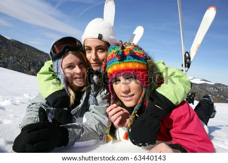 Young women laid in snow - stock photo
