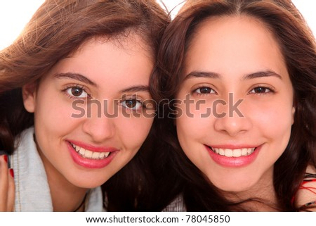 young women looking at camera over white background