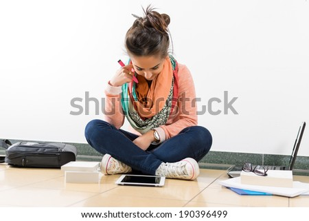 Young women looking on her tablet for the latest world news - stock photo