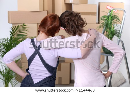 young women moving into a new flat - stock photo