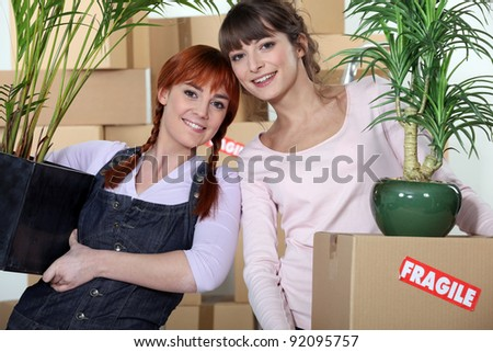 Young women moving into their new apartment - stock photo