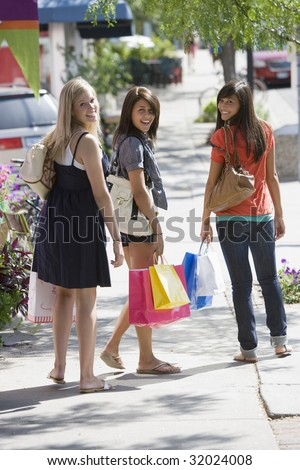 Young women on a shopping trip - stock photo