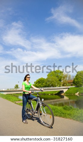 Young women  on bicycle