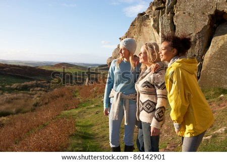 Young women on country walk - stock photo