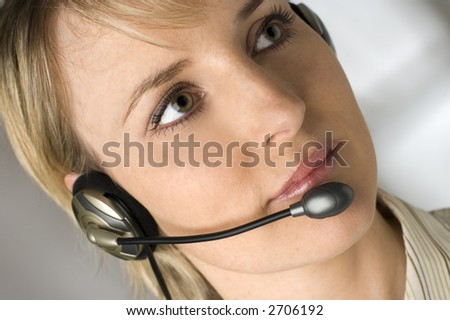 young women operator with headphones close up shoot - stock photo