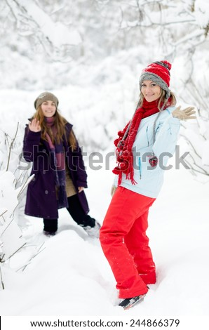 young women outdoor in winter enjoying the snow - stock photo