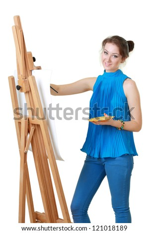 young women painter with easel isolated over white - stock photo