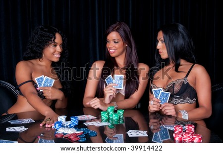 Young women playing poker in lingerie very happy. - stock photo