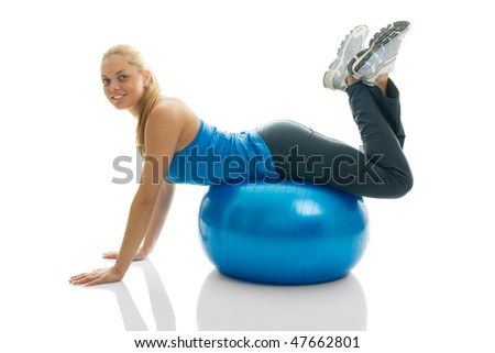 Young women posing on fitness ball. Isolated on white - stock photo