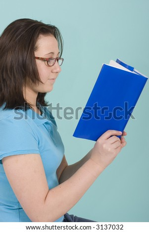 young women reading with a blue background with copy space
