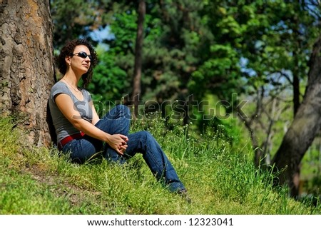 young women relaxes in the green