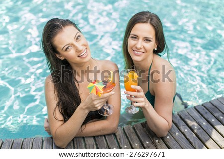 Young women relaxing in the swimming pool - stock photo