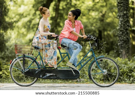Young women riding on the bicycle