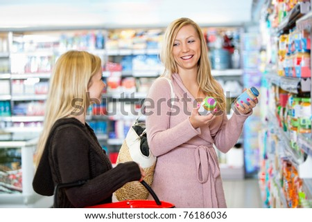 Young women shopping together in the supermarket - stock photo