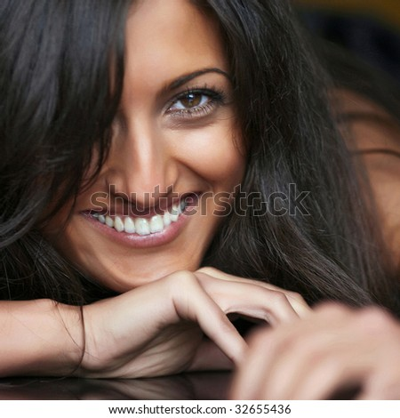 Young women shows off her beautiful teeth - stock photo